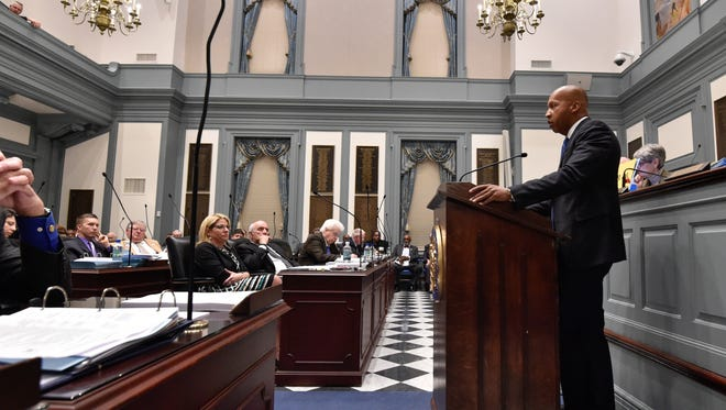 Bryan Stevenson with Equal Justice Initiative, answers questions from Rep. Sean Lynn D-Dover in the house chamber before the vote on SB 40 to repeal the death penalty in Delaware.