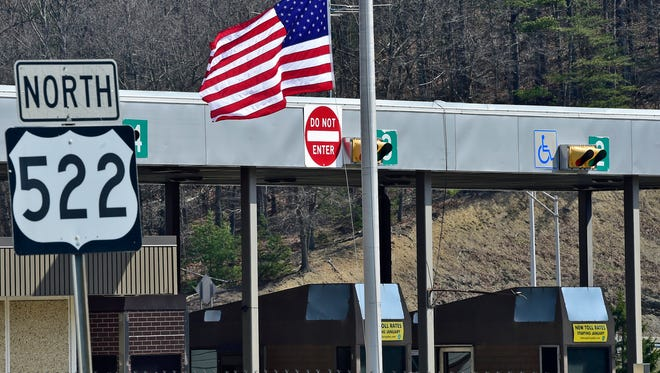 An American flag flies at half-staff, as seen at the Fort Littleton toll booth along Route 522 in Fort Littleton Tuesday, March 22, 2016. Two workers were shot and killed during a robbery, Sunday. Police said retired PSP trooper Clarence Briggs, Newville,  was killed in a shootout with troopers who responded to the scene. Gov. Tom Wolf ordered flags to fly at half-staff in Fulton and York counties to honor Danny Crouse and Ronald Heist who were killed during the robbery on Fulton County.
