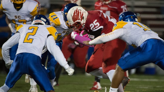 Smyrna's William Knight (25) runs the ball in the first quarter in their home game against Sussex Central.