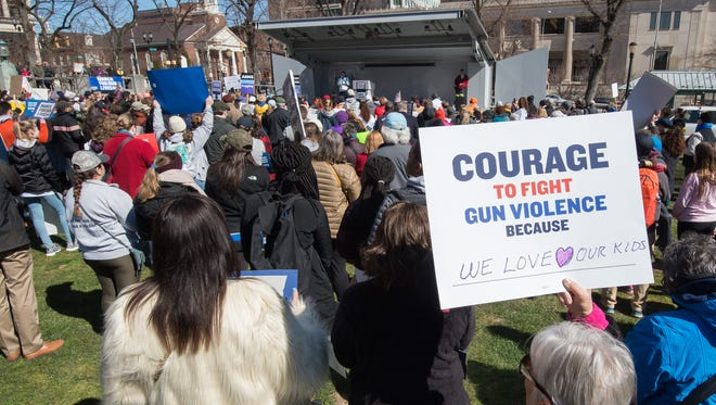 A protester holds a sign during the March for Our Lives protest at Rodney Square in Wilmington.