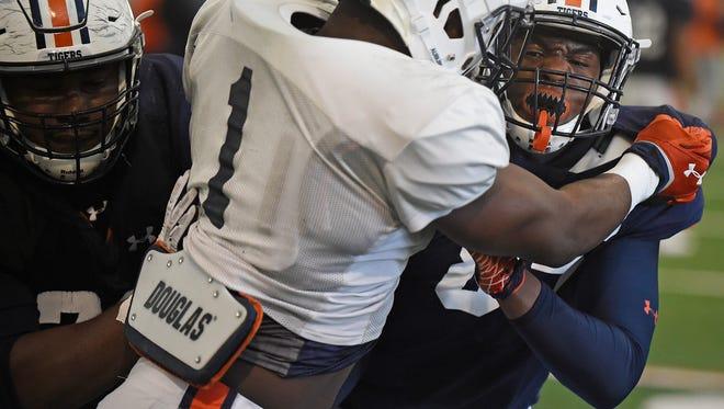Prince Tega Wanogho and Jalen Harris block Markaviest Bryant.during a Auburn football spring practice on Wednesday, March 6, 2018 in Auburn, Ala.