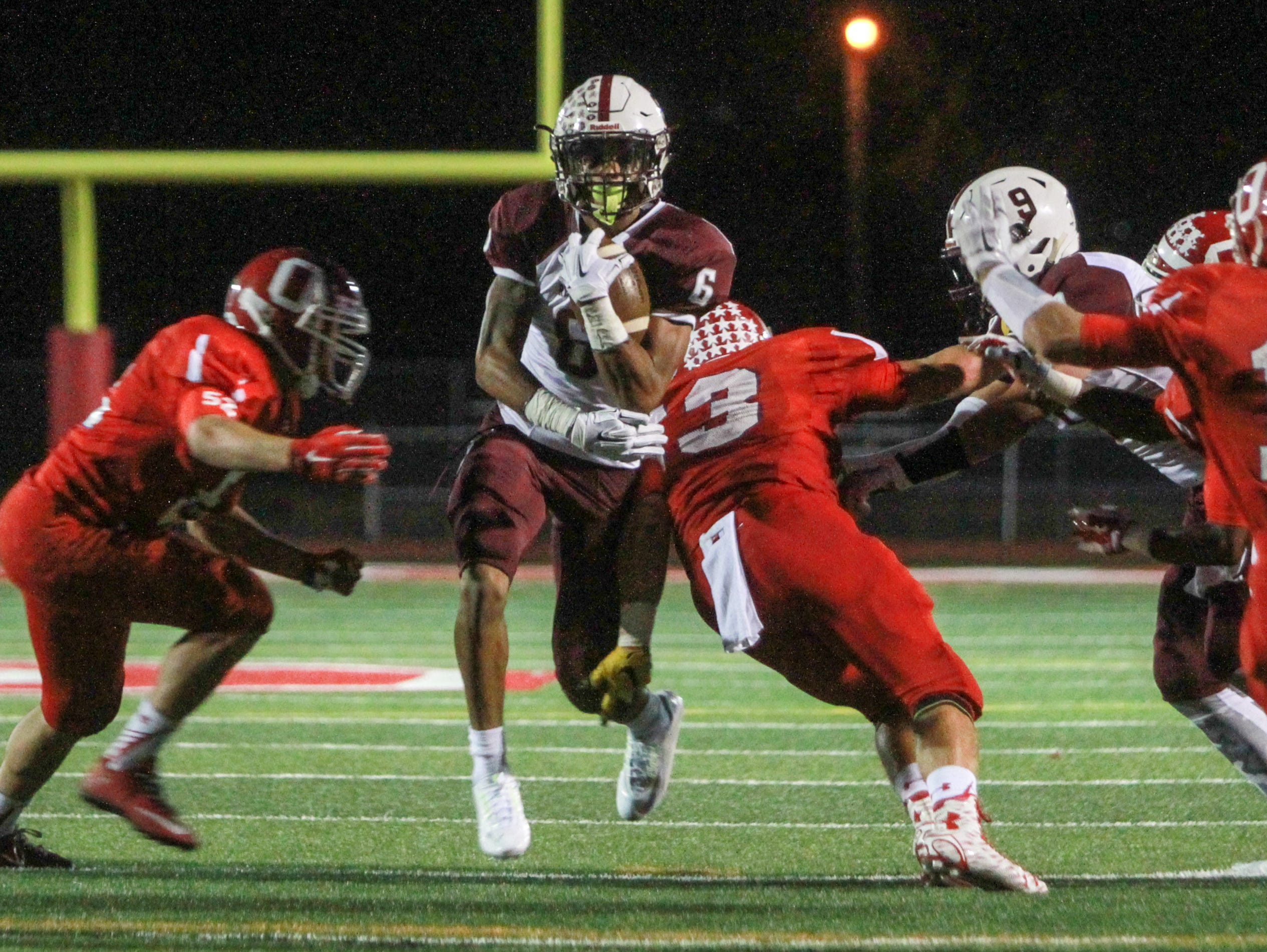 Ocean, NJ Red Bank at Ocean Friday night football. Red Banks #6 Sadig Palmer carries the ball in the first quarter. 092415