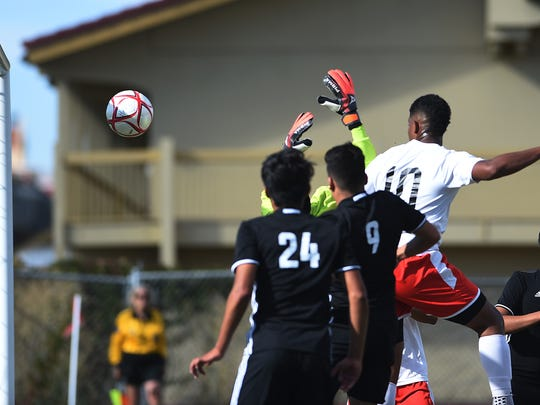 Wooster's Kendric Duve (10) scores on a corner kick while taking on North Valleys during their soccer game in Reno on Sept. 21, 2016.