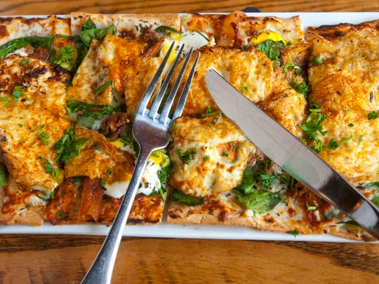 Somewhere Restaurant and Bar's breakfast flatbread is like a breakfast pizza. Its made with ricotta sauce (lemon and parmesan cheese,) fresh spinach, fresh mozzarella, chopped bacon, egg and basil.Jan. 10, 2018