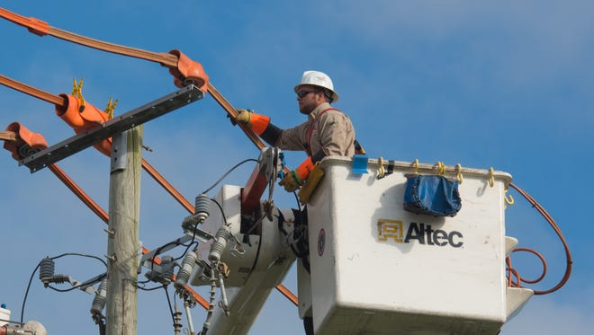 Gulf Power Company lineworkers make infrastructure upgrades in this file photo.