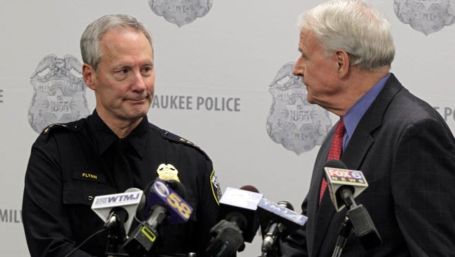 Mayor Tom Barrett (right) congratulates Milwaukee Police Chief Edward Flynn after the chief announced his retirement, which will take effect Feb. 16.