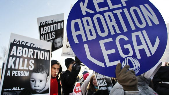 Demonstrators rally for and protest abortion rights.