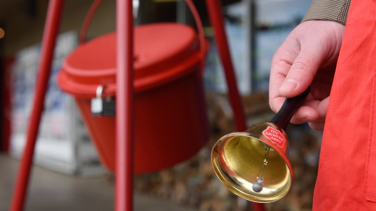 Bell ringers seek donations at McDade's Market at Maywood Shopping Center in Jackson Thursday.
