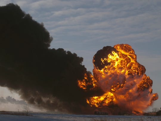 Oil train accidents such as this one Dec.30 in Casselton, N.D., are prompting U.S. and Canadian accident investigators to push their governments to take a series of safety measures. Bruce Crummy/AP FILE