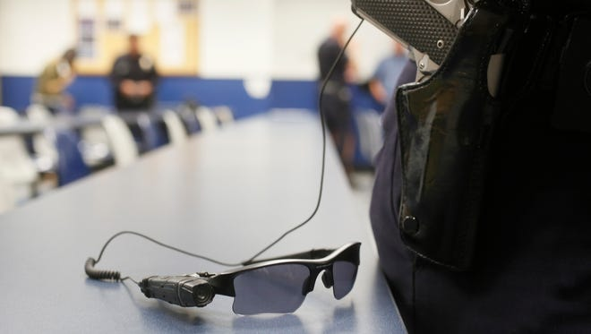 This Jan. 15, 2014, file photo shows an on-body police video camera clipped to a Los Angeles Police officers' glasses during a demonstration for media in Los Angeles. Nationally, about 1 in 6 officers has been outfitted with a body camera.