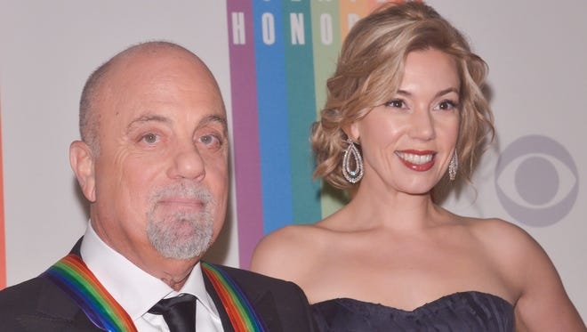 Billy Joel and Alexis Roderick pose on the red carpet during the 36th Kennedy Center Honors gala at the Kennedy Center on December 8, 2013 in Washington, DC.