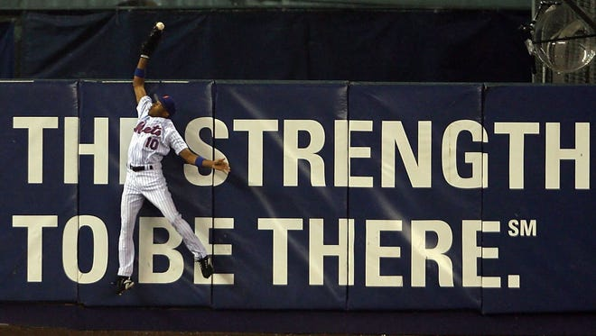 Endy Chavez makes a stunning catch for the Mets in the sixth inning of Game 7 of the 2006 National League Championship Series. The Mets eventually lost the game to the St. Louis Cardinals.