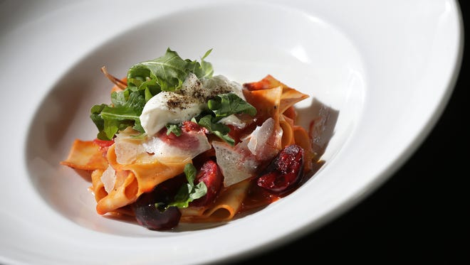 The Beet Pappardelle with manchego, homemade semolina flour pasta, horseradish crema and oxtail au jus.