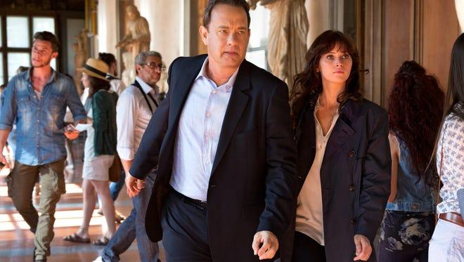 Tom Hanks, seen here with Felicity Jones, has his third go as symbologist Robert Langdon in 'Inferno.'