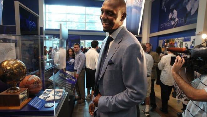 "August 30, 2011 -  Penny Hardaway looks over some Tiger memorabilia during the grand opening of the Anfernee ""Penny"" Hardaway University of Memphis Athletic Hall of Fame Tuesday.   (Photo by Nikki Boertman / The Commercial Appeal)"