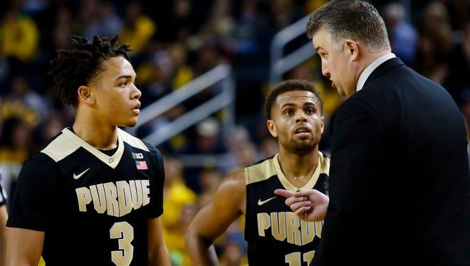 Purdue coach Matt Painter talks to guard Carsen Edwards (3) and guard P.J. Thompson (11) in the second half against Michigan at Crisler Center on Feb. 25, 2017. Michigan won 82-70.