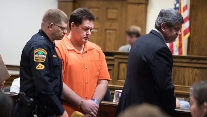 Todd Kohlhepp leaves the courtroom after pleading guilty to 14 charges and being sentenced to seven consecutive life prison terms at the Spartanburg County Courthouse on Friday, May 26, 2017.