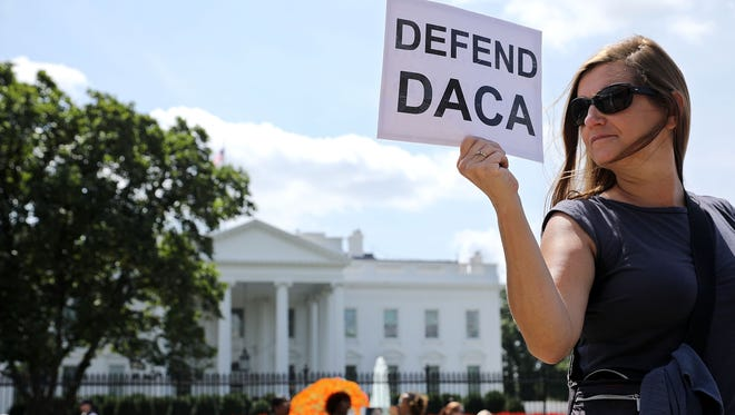 Protesters demonstrate outside the White House on August 30, 2017, to urge President Trump to maintain the Deferred Action for Childhood Arrivals program, or DACA, which protects young undocumented immigrants from deportation.