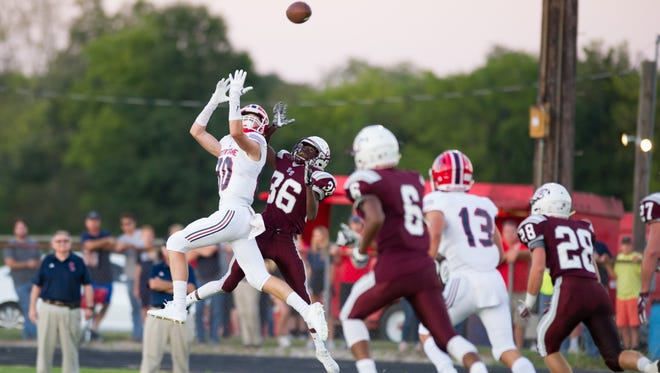 Notre Dame wide receiver Gentry Borill (80) goes up for an over-the-shoulder catch against Breaux Bridge's Lamar Abraham on Friday in the Pios' 38-7 victory.