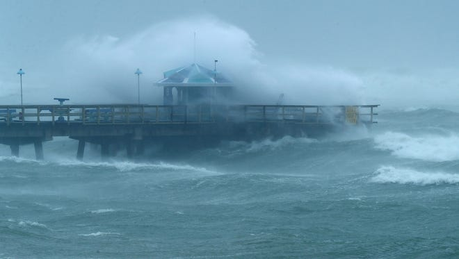 Large waves produced by Hurricane Irma crash into the end of Anglins Fishing Pier in Fort Lauderdale, Fla., on September 10, 2017.