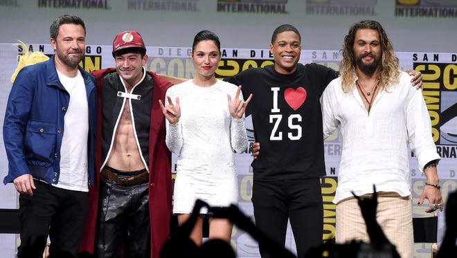 "(L-R) Ben Affleck, Ezra Miller, Gal Gadot, Ray Fisher, and Jason Momoa from ""Justice League"" attend the Warner Bros. Pictures Presentation during Comic-Con International 2017 at San Diego Convention Center on July 22, 2017 in San Diego, California."