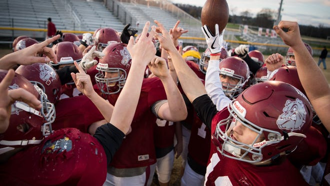 Cornersville players huddle up before a drill during practice at Cornersville High School in Cornersville, Tenn., Tuesday, Nov. 21, 2017.