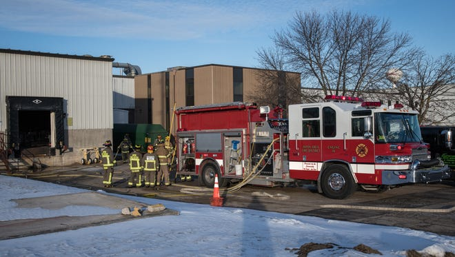 The Ripon Area Fire Department, along with other local departments, respond Monday, Jan. 8, 2018, to a report of an explosion at Signature Wafer Co., 850 Stanton St., Ripon.