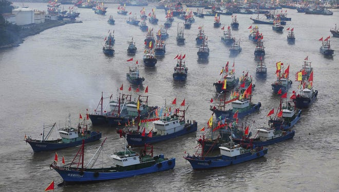 Fishing boats set off from Shipu port for fishing on Sept. 16, 2015, in Ningbo, China. Thousands of fishing boats set sail for fishing after a three-and-a-half month fishing ban in the East China Sea.