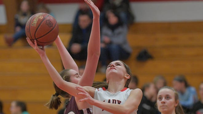 Quinn Godfroy (1) of Lourdes fights her way for a shot. The Lourdes Academy Knights hosted the Elkhart Lake-Glenbeulah Resorters in a WIAA Division 5, Sectional 4 game Friday evening, February 23, 2018 at the Castle.