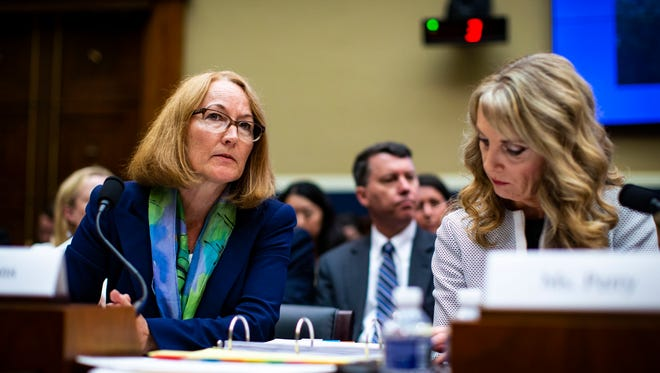 Susanne Lyons, acting chief executive officer and president of the U.S. Olympic Committee, left, and Kerry Perry, President and CEO of USA Gymnastics, testify during a House Committee on Energy and Commerce Subcommittee on Oversight and Investigations hearing May 23.