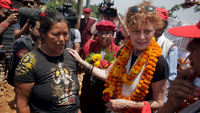 Oscar-winning Hollywood actress Susan Sarandon (R) comforts Kanti Maya Tamang, who lost her husband and daughter in the April 25 earthquake, at Ramkot village on the outskirts of Kathmandu, Nepal, Sunday, May 24, 2015.