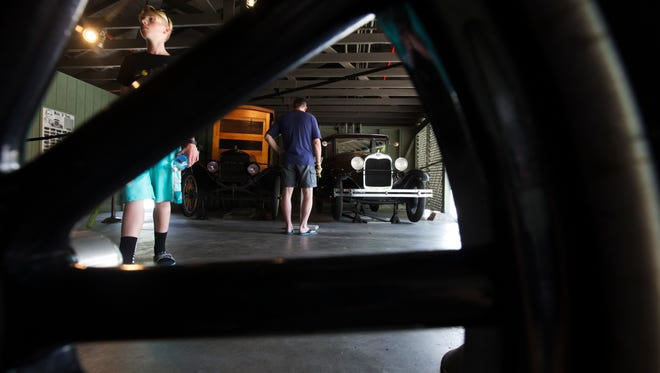 Visitors to the Edison & Ford Winter Estates browse through the Ford vehicles on Thursday.