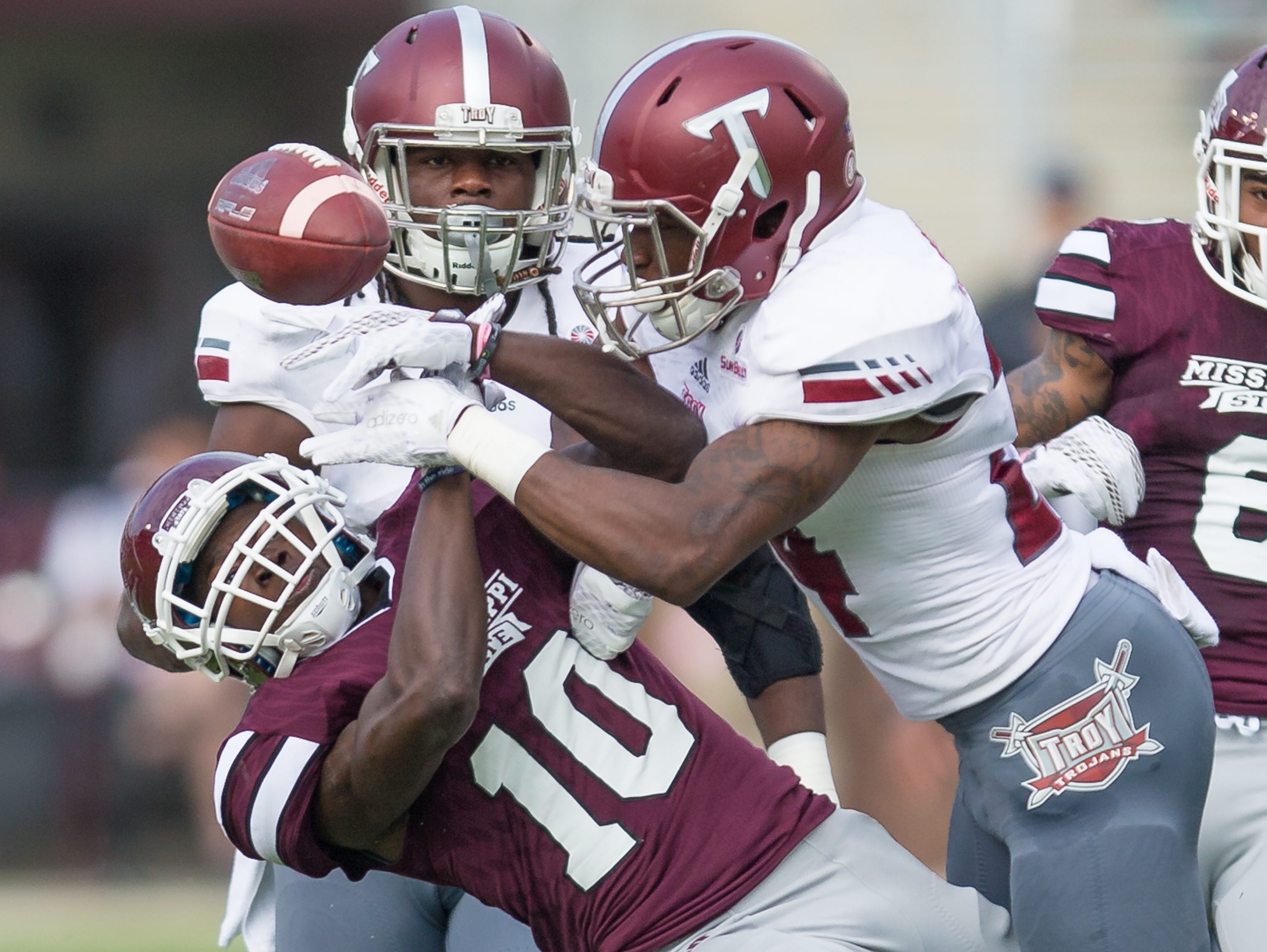 Mississippi State running back Brandon Holloway (10) is hit by Troy's JaQuadrian Lewis (14), Mississippi State played Troy in a college football game on Saturday, October 10, 2015 at Davis Wade Stadium in Starkville. Photo by Keith Warren (Mandatory Photo Credit)