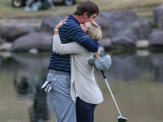 Hudson Swafford hugs his wife Katherine just after