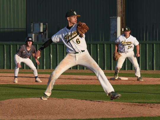 Captain Shreve's Cameron Meeks pitches in their game