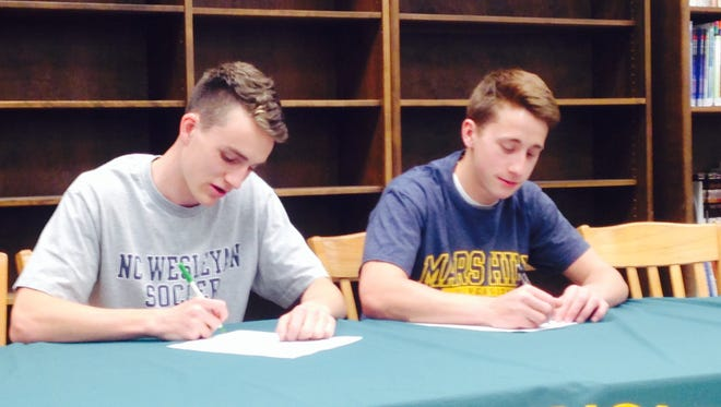 Reynolds seniors Urijah Morrison, left, and River Naisang have signed to play college soccer.