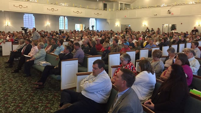 A Thursday community meeting over Brighton Center's plans for a women's substance abuse recovery center drew a strongly divided and vocal crowd of over 300 people.