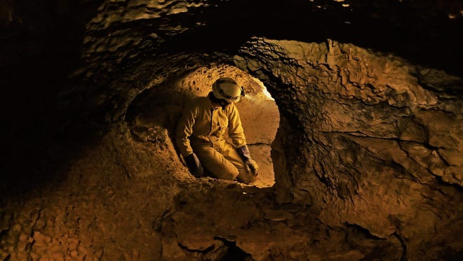 Chris Campbell takes a break during a cave survey.