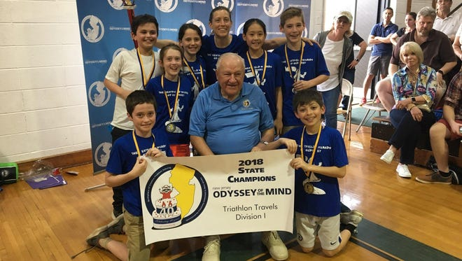 Members of the Wilson School team from Westfield pose for a picture with Dr. Sam Micklus, founder of Odyssey of the Mind, after the 40th Annual New Jersey State Odyssey of the Mind Tournament on April 15.  The Wilson team joins its fellow Westfield team from McKinley School in advancing to the Odyssey of the Mind World Finals in May.  (L-R):  Chloe Yu, Ted Crall, Michael Fisher, Neil Shastri, Logan Partridge, Emma Crall, and Jake Park.