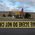 AURORA, CO - JULY 23:  Crime scene tape surrounds the Century 16 movie theater where 12 people were killed in a shooting rampage last Friday, on July 23, 2012 in Aurora, Colorado.  Suspect James Holmes, 24, allegedly went on a shooting spree and killed 12 people and injured 58 during an early morning screening of 'The Dark Knight Rises.'  (Photo by Kevork Djansezian/Getty Images)