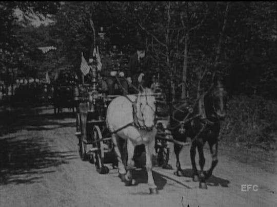 A horse-drawn fire wagon travels down Passaic Avenue during a Nutley parade, depicted in a rare 1918 film.