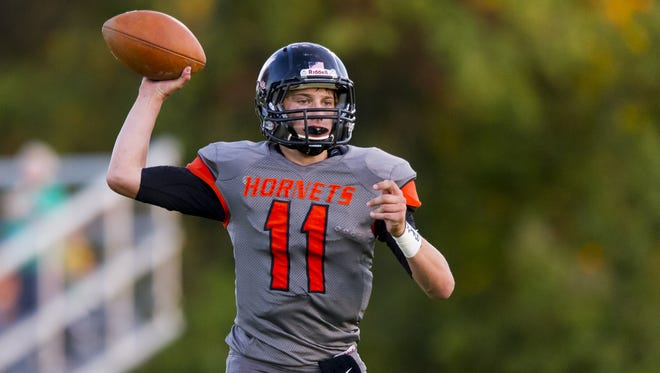 Beech Grove High School sophomore Chase Andries (11) drops back to throw the ball into the end zone for a two-point conversion during the first half of action. Beech Grove High School hosted Monrovia High School in varsity football action, Friday, September 26, 2014.