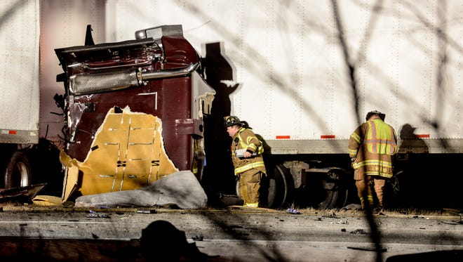 Rescue crews are at work at four-vehicle crash Friday, Nov. 20, 2015, on Interstate 78 in Union Township. Two people from Middletown were killed in the crash.