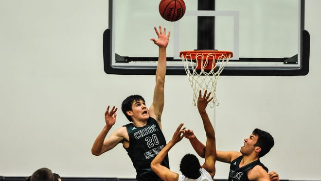 Christ School senior John Fulkerson (20) led the Greenies with 23 points on Tuesday at Asheville Christian Academy.