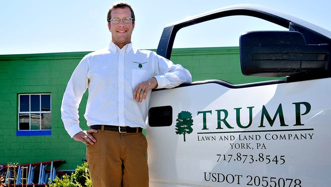 Mike Trump stands next to one of the Trump Lawn and Land company trucks outside the West Manchester Township business Tuesday, April 12, 2016. He started the family business 14 years ago, long before Donald Trump's political aspirations came to light. Dawn Sagert photo