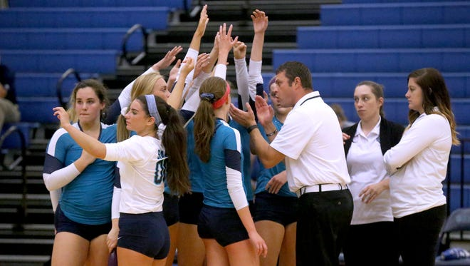 Coach Shawn Robinson (right) and his Siegel High School volleyball squad won the Region 4-AAA title Tuesday.