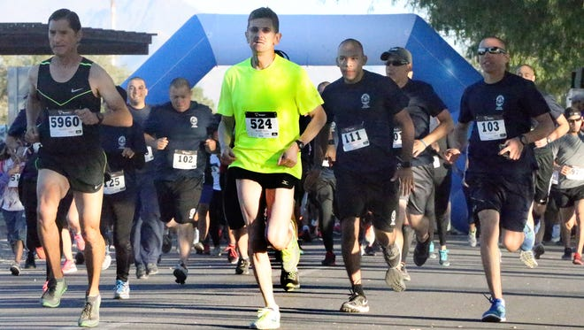 Armando Meza, center, starts out on the Zombie Escape 5K Run Sunday at Ascarate Lake. Meza would be the first male to finish. More than 600 people registered for the event. The event raised money and awareness for Spice Is Not Nice, a local anti-drug organization.