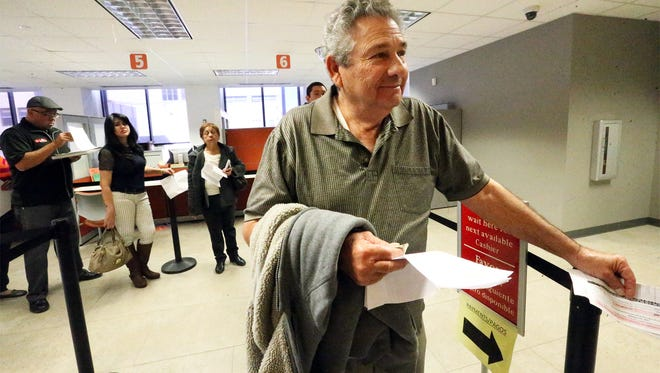 George Cordova paid off his home mortgage loan about 40 years ago and has paid his own property taxes ever since. He waited last week to pay his property taxes at the city's Consolidated Tax Office in the Downtown Wells Fargo building. Jan. 31 was the last day to pay property taxes without late penalties.