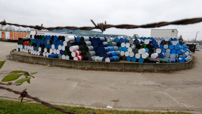 Steel drums are stacked outside of the IndyDrum plant, in Indianapolis, that's part of the CLCM group of drum reconditioners.