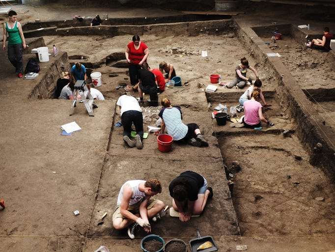 Students from Augustana College and the University of Exeter in England work inside an archaeological dig inside the Thomsen Center Archeodome on Wednesday, June 25, 2014, at the Mitchell Prehistoric Indian Village in Mitchell, S.D.